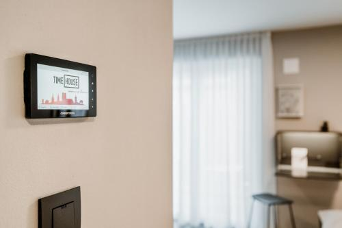 A television and/or entertainment center at Timehouse Serviced Apartments