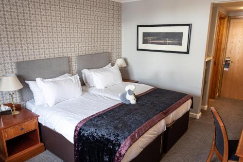 A bed or beds in a room at Low Wood Bay