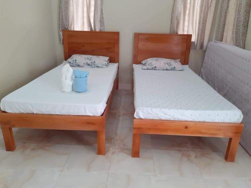 A bed or beds in a room at D's Oceanview Beach Resort