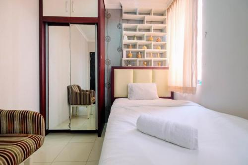 A bed or beds in a room at Homey 2BR Cervino Village Apartment By Travelio