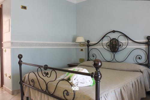 Letto o letti in una camera di Villa Afrodite