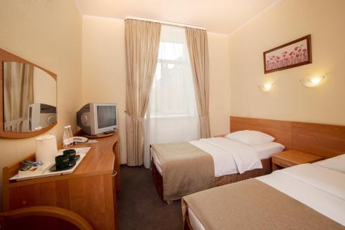 Кровать или кровати в номере Отель Максима Ирбис
