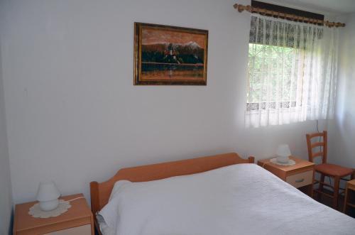 Posteľ alebo postele v izbe v ubytovaní Apartments Lenardic