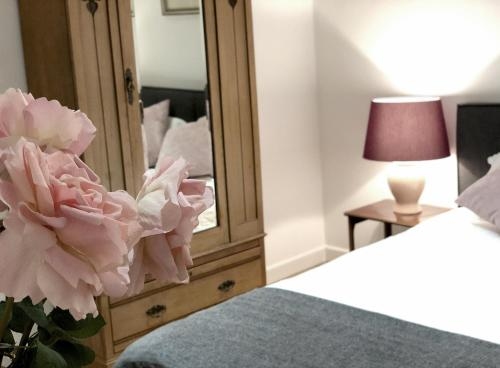 A bed or beds in a room at Westcombe Park