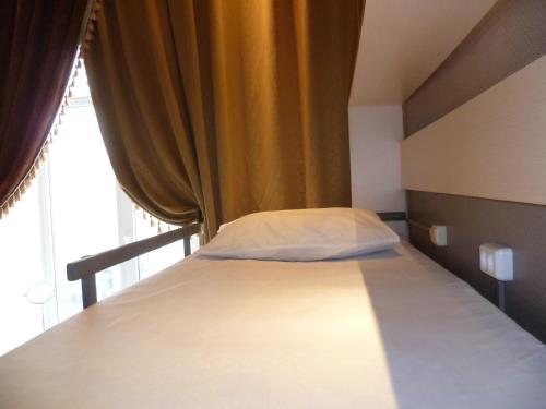 Кровать или кровати в номере Teremok Hostel