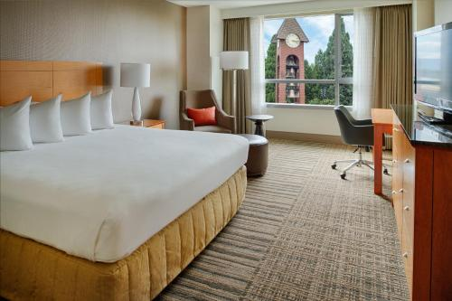 A bed or beds in a room at Hilton Vancouver Washington