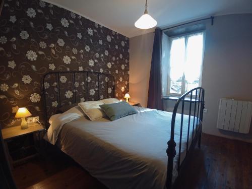 Un ou plusieurs lits dans un hébergement de l'établissement Le Moulin des Valignards - Chambres d'hôtes