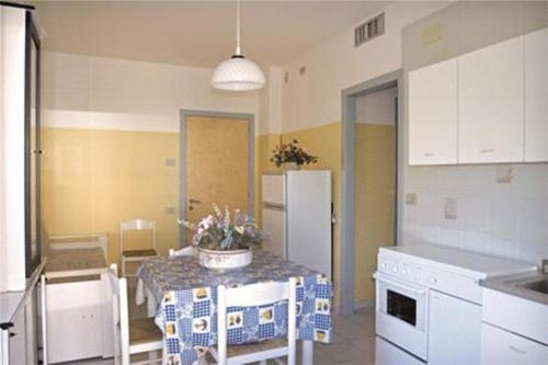 A kitchen or kitchenette at Residence Nettuno