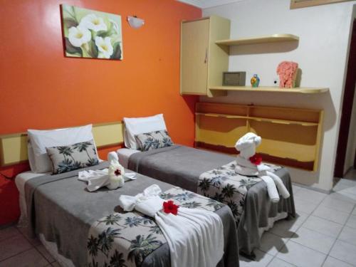 Cama ou camas em um quarto em Pousada Recifes de Corais