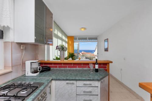 Kuchyňa alebo kuchynka v ubytovaní Apartments Bole