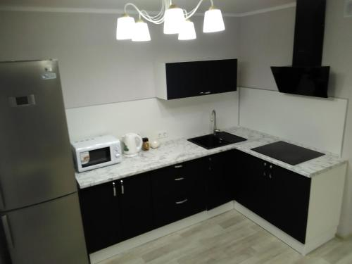 Кухня или мини-кухня в Studio on Chulman