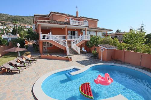 The swimming pool at or near Villa Paradise