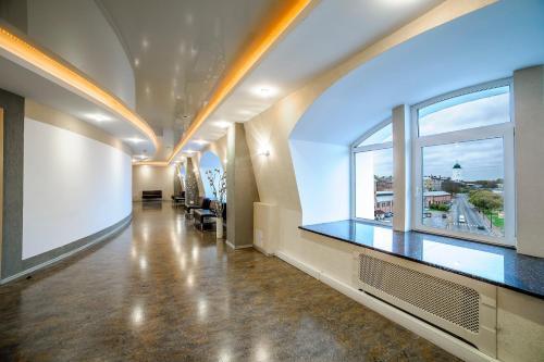 Лобби или стойка регистрации в Victoria Hotel Vyborg