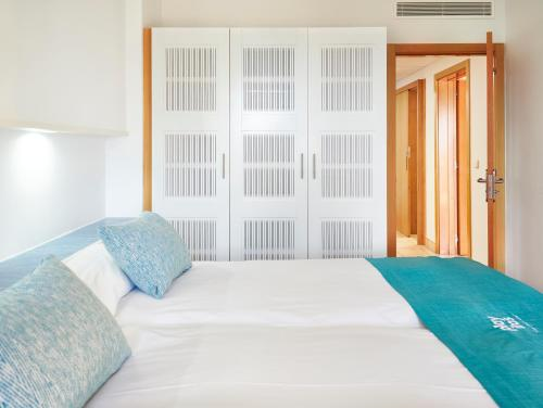 A bed or beds in a room at Playitas Aparthotel - Sports Resort