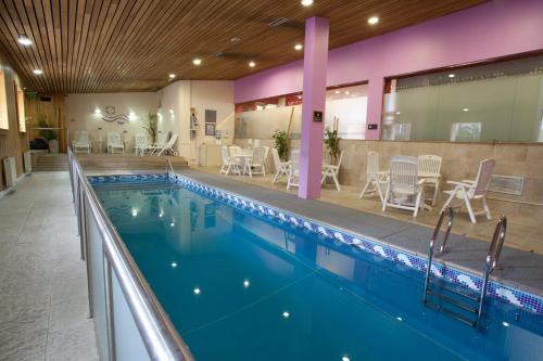 The swimming pool at or near Hotel Canal Beagle