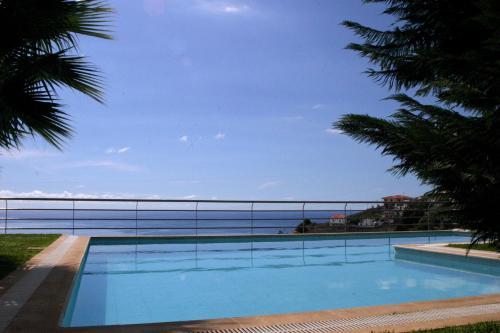 The swimming pool at or near Casa do Papagaio Verde