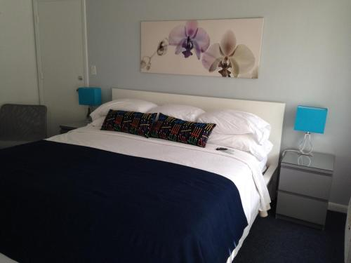 A bed or beds in a room at Cheston House - Clothing Optional All Male Guesthouse