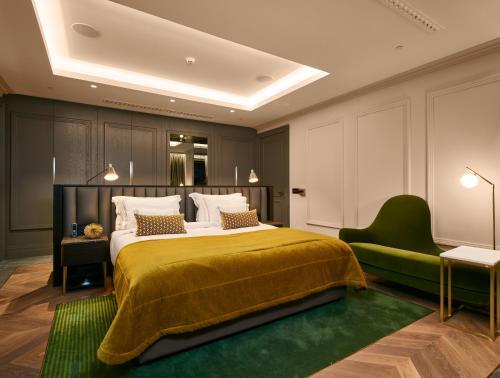 Ein Bett oder Betten in einem Zimmer der Unterkunft Ikador Luxury Boutique Hotel & Spa