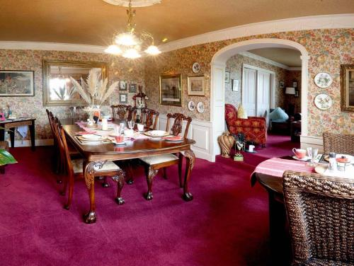 A restaurant or other place to eat at Budleigh House