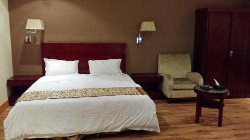 Cama ou camas em um quarto em Raoum Inn Khafji Southern