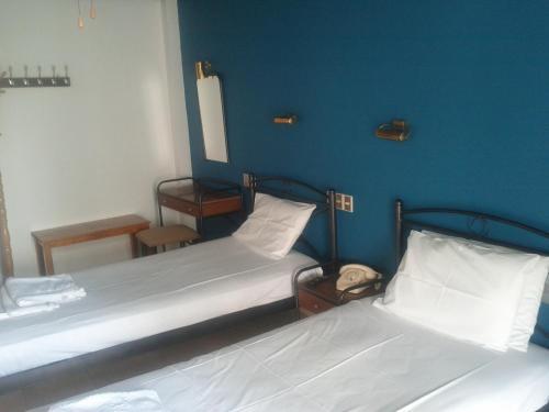 Ένα ή περισσότερα κρεβάτια σε δωμάτιο στο Ταίναρο