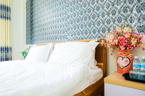 A bed or beds in a room at Memory Homestay Hue