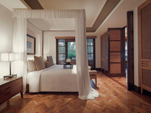 A bed or beds in a room at The Legian Bali