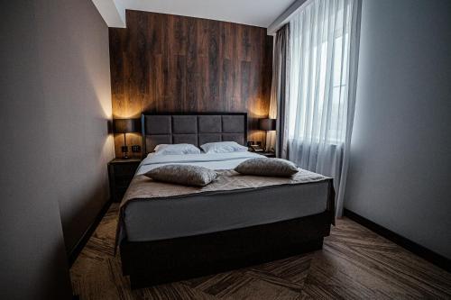 Кровать или кровати в номере Business-Hotel Element