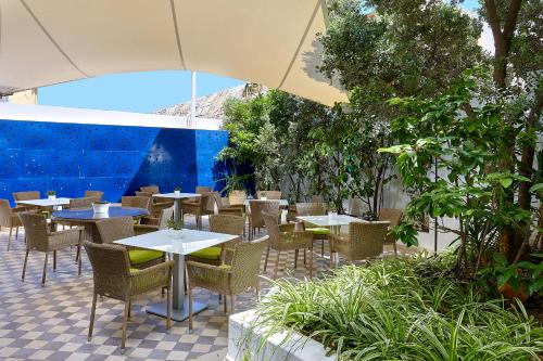 A restaurant or other place to eat at Atrion Hotel