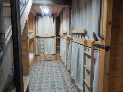 A bunk bed or bunk beds in a room at La plazuela verde