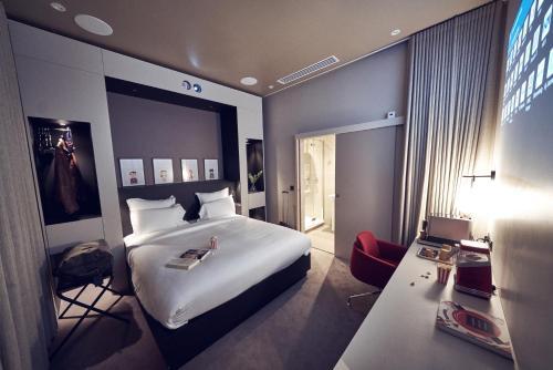 Un ou plusieurs lits dans un hébergement de l'établissement Maison Nô - Hôtel et Rooftop