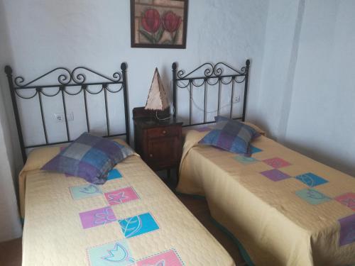 Cama o camas de una habitación en La Villa Priego de Cordoba