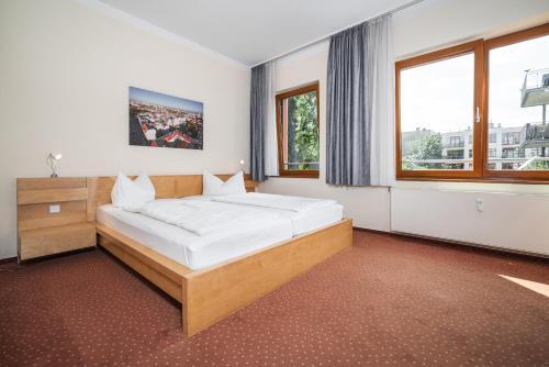 Ein Bett oder Betten in einem Zimmer der Unterkunft Hotel 26