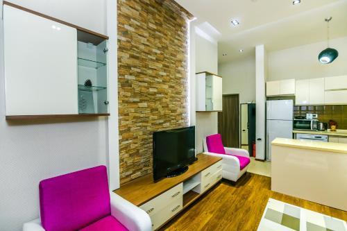Uma TV ou centro de entretenimento em LUX apartment near in Hard Rock