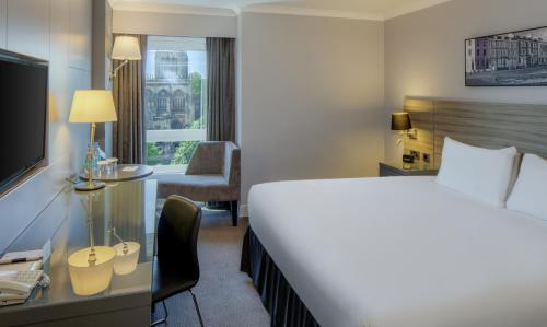 A bed or beds in a room at DoubleTree by Hilton Bristol City Centre