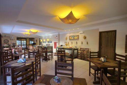 Um restaurante ou outro lugar para comer em Pousada Porto Mare