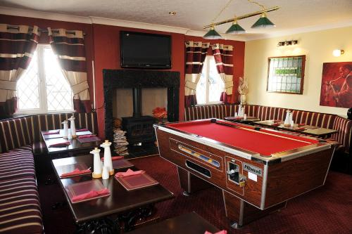 A pool table at The Old Mill Inn