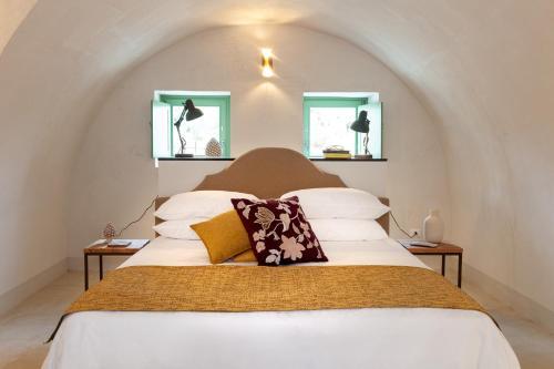 Letto o letti in una camera di Terre di Romanello - Relais in Val di Noto