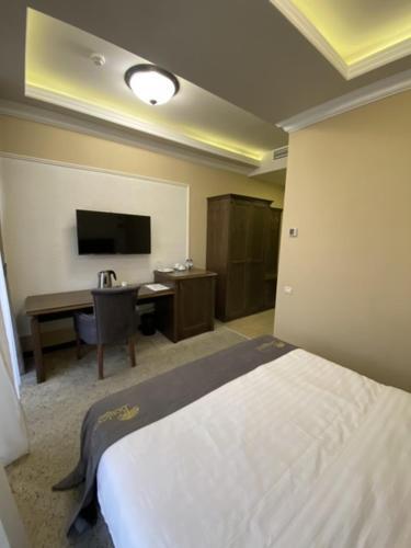 Кровать или кровати в номере Отель Бульвар