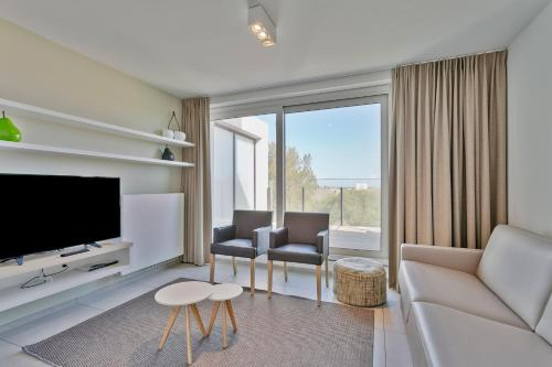 A seating area at Belcasa Family Suites & Lofts
