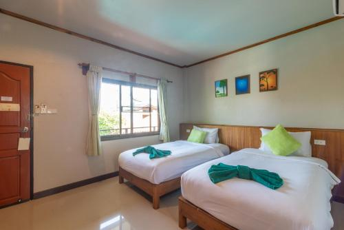 A bed or beds in a room at Medio De Pai