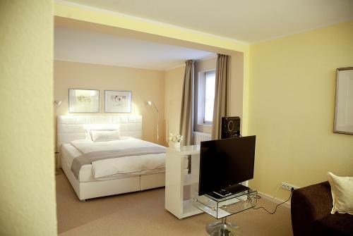 Ein Bett oder Betten in einem Zimmer der Unterkunft Arthotel ANA Fleur