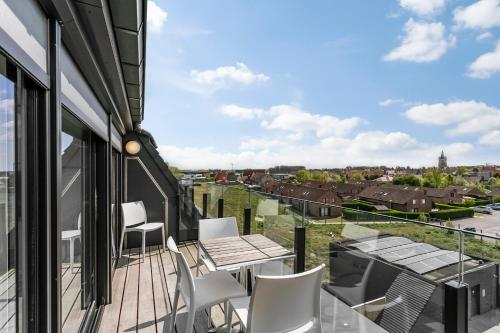 A balcony or terrace at Belcasa Family Suites & Lofts