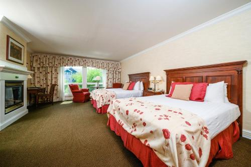 A bed or beds in a room at Stoweflake Mountain Resort & Spa