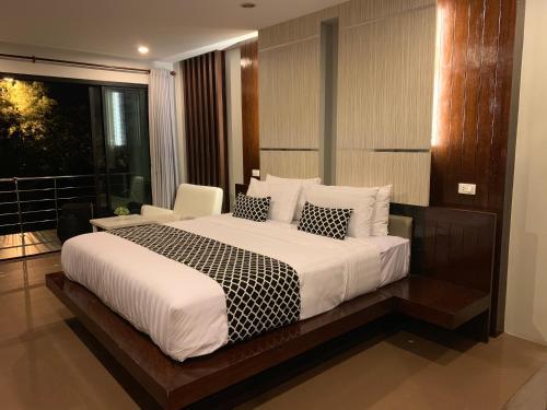 En eller flere senge i et værelse på Phi Phi Ton Sai Place