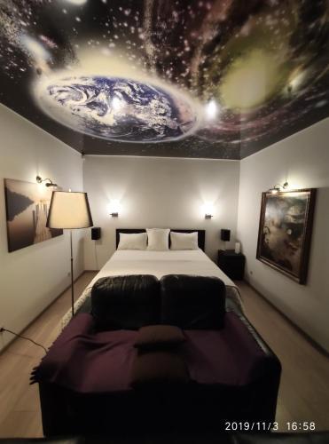 Кровать или кровати в номере Apartment Sergey