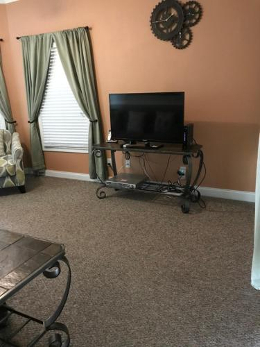 A television and/or entertainment centre at Grand Palms 8831-B