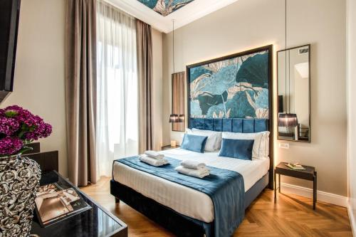 A bed or beds in a room at Hotel 55 Fifty-Five - Maison d'Art Collection