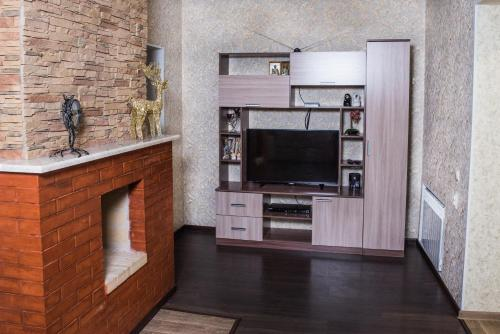 Телевизор и/или развлекательный центр в Апартаменты на Карла Маркса 9