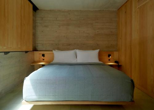 A bed or beds in a room at Hotel Escondido Oaxaca